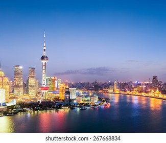 colored lights illuminate the shanghai when night falls