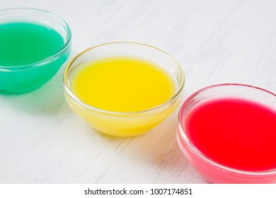 colored liquid on a white wooden background