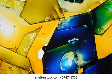 Colored liquids mixed together in fluid creating colorful abstract painting