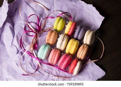 colored macarons  on a violet paper