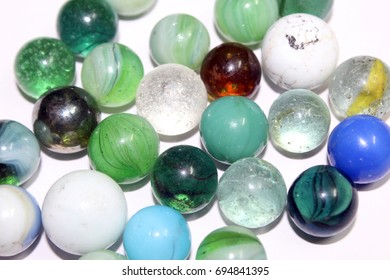 Colored marbles balls with white background.