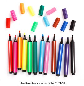 colored markers on the white background