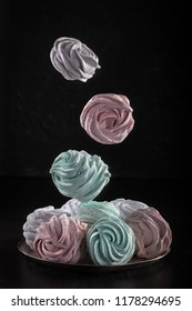 Colored Marshmallow or Zephyr   flying in freeze motion. Concept of flying food. Homemade sweets