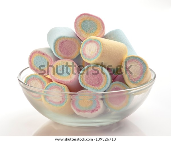 colored marshmallows group in in glass bowl on white base