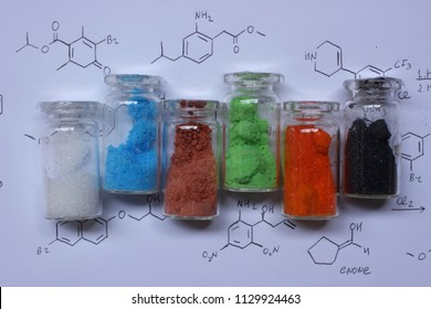Colored metal salts: white zinc sulfate, blue copper sulfate, brown cobalt sulfate, green nickel chloride, orange ammonium dichromate, black potassium permanganate.