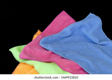 colored microfiber cleaning cloths, orange, pink, blue,green colored microfiber cloths black back ground,