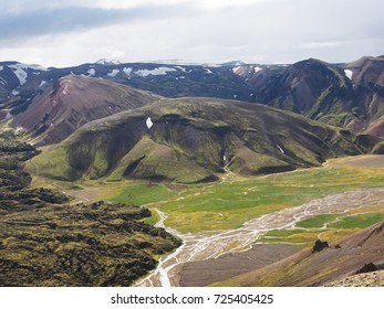 Colored mountains and lava fields in the Landmannalaugar valley, Iceland