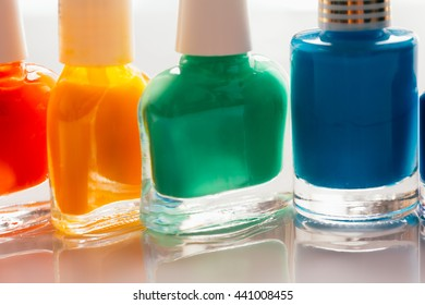 colored nail polish on a white background.