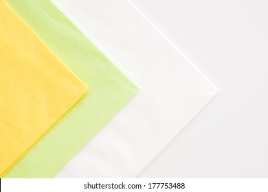 colored napkins - yellow, green and white on white background Greenery  - trend color 2017
