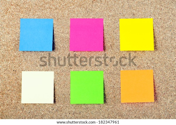 Colored notes paper on a cork board
