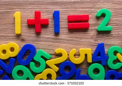 Colored numbers scattered on the wooden table