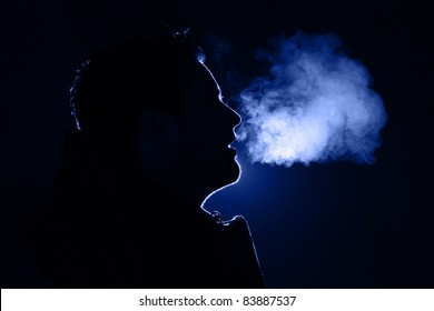 Colored outline of a man exhaling warm breath