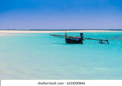 Colored outrigger fishermen pirogue moored on turquoise sea of Nosy Ve island, Indian Ocean, Madagascar