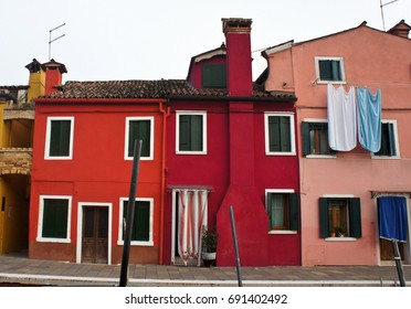 Colored paint facades of houses on the island of Burano, Italy