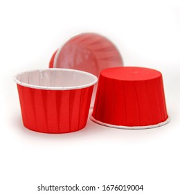 Colored paper capsule for cake on a white background
