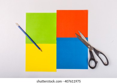 Colored paper sheets prepared for application. With pencil and scissors. Ready to child work in school or preschool.