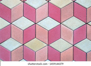 colored paving slabs by mosaic, closeup. Road paving construction. Tessellated sidewalk tile