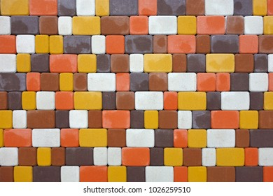 Colored paving slabs in the form of bricks