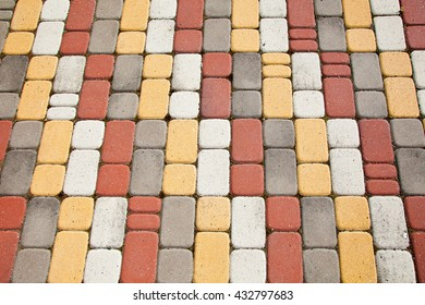 Colored paving tiles. Pedestrian road in the Park. A textured background.
