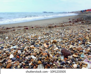 Colored pebbles on the beach