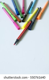 Colored pen on white background.