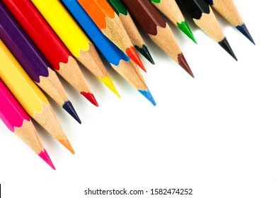 Colored pencils background. Color pencils on white background. - Shutterstock ID 1582474252