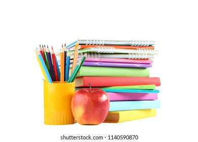 Colored pencils with books on white background