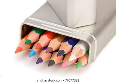 Colored pencils in a brushed aluminum case.