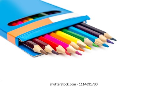 Colored pencils in carton pencil box on white.