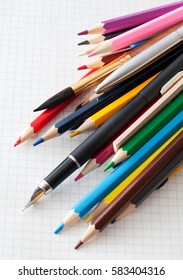 Colored pencils close-up lying on a sheet of paper