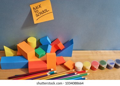 Colored pencils, cubes and paints for the development of the child.