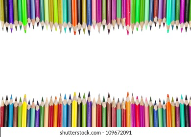 Colored pencils forming a border with copy space. shot in studio