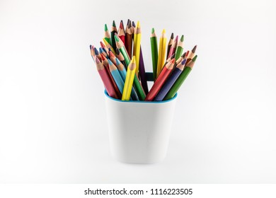 Colored Pencils in Holder Isolated on White Background.