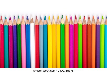 Colored pencils isolated on white background with shadow