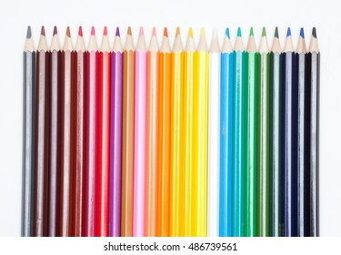 Colored pencils lying on a white paper