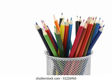 Colored pencils in metal office pencil holder isolated on white background