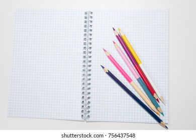 colored pencils and a notebook