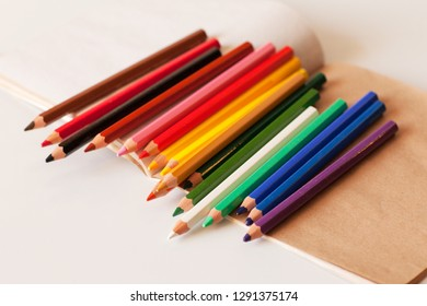 Colored pencils on a light background. Drawing. Creativity. Art