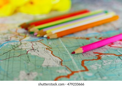 colored pencils on the map