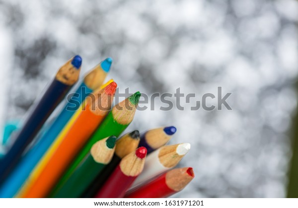 Colored pencils on a school composition notebook