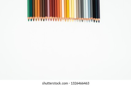 Colored pencils on a white background