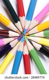 Colored pencils organized in a nice way on a while isolated background.