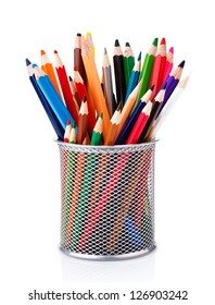 colored pencils in a pencil cup on a white background