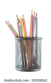 colored pencils in pot rack over white background