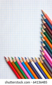 colored pencils at school notebook