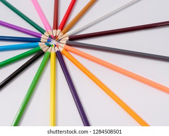 colored pencils sharpened on a white background.