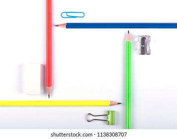 Colored pencils with stationery forming a square