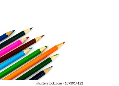 colored pencils with visible details on a white background