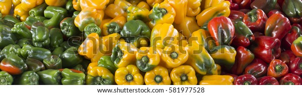 Colored peppers in street market store