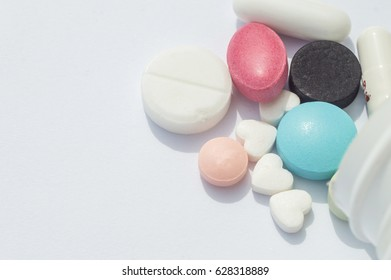 colored pills and jar